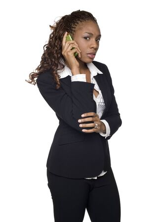 Isolated studio shot of an upset businesswoman talking on her cellphone. photo