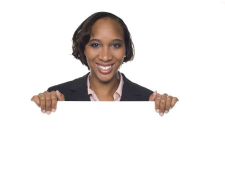 pantsuit: Isolated studio shot of a businesswoman holding a big blank sign. Stock Photo