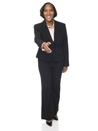Isolated studio shot of a businesswoman reaching out to shake hands. Banque d'images