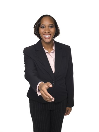 Isolated studio shot of a businesswoman reaching out to shake hands. Stock Photo