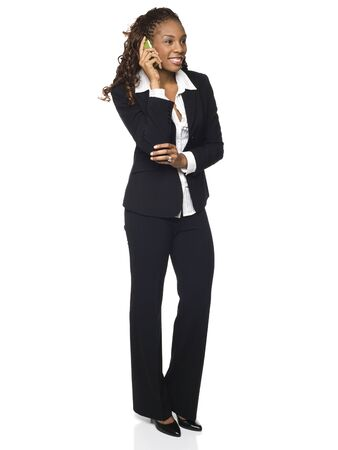 Isolated studio shot of a businesswoman talking on her cellphone. photo