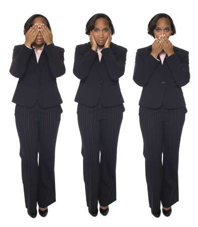 Isolated studio shot of a businesswoman in the Speak No Evil, Hear No Evil, Speak No Evil poses. photo