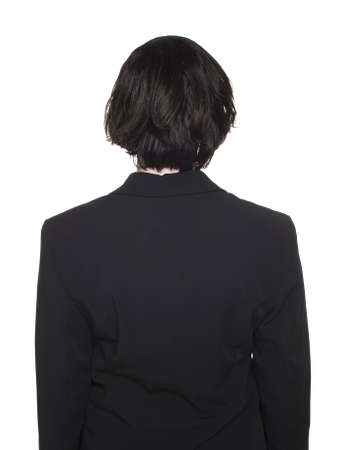 Isolated studio shot of a businesswoman viewed from behind. photo