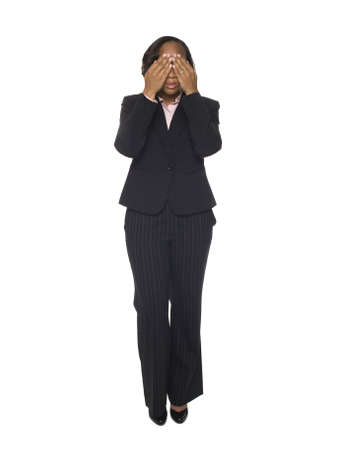 Isolated studio shot of a businesswoman in the See No Evil pose. Stock Photo - 8080976