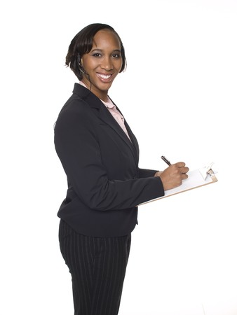 Isolated studio shot of a businesswoman wearing a headset telephone and writing on a clipboard. Stock Photo - 8081173