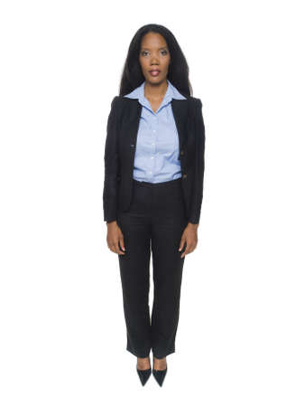 rotational: Isolated full length studio shot of the front view of a female African American businesswoman as she looks at the camera (part of a rotational series).