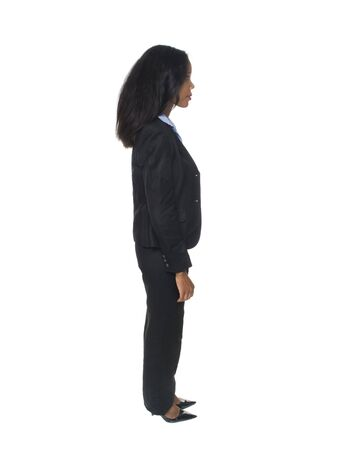 rotates: Isolated full length studio shot of the side view of a female African American businesswoman as she rotates through 360 degrees (series).