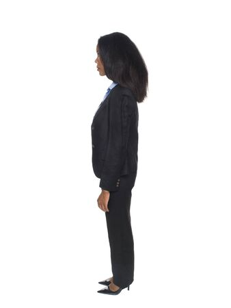 Isolated full length studio shot of the side view of a female African American businesswoman as she rotates through 360 degrees (series).