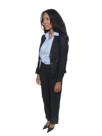 Isolated full length studio shot of the front view of a female African American businesswoman as she looks away to her left (part of a rotational series). Stock Photo
