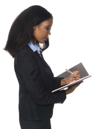 left handed: Isloated full length studio shot of an African American woman writing on her notepad.