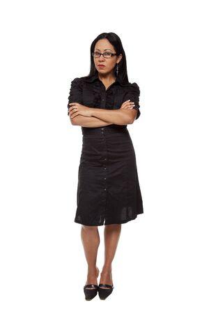 persona enojada: Chupito de estudio aislado de una empresaria Latina con una expresi�n de popa mirando la c�mara disapprovingly.  Foto de archivo