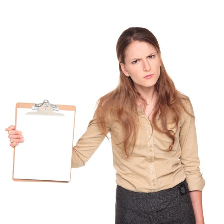 Isolated studio shot of a Caucasian businesswoman looking angrily at the camera while holding out a blank clipboard.
