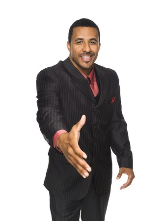 Isloated studio shot of an African American businessman reaching out to the camera to shake hands. photo