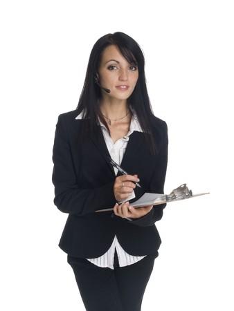 Chupito de estudio aislado de una empresaria con un auricular del teléfono.