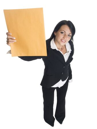 just arrived: Isolated studio shot of a businesswoman holding up a letter that just arrived.