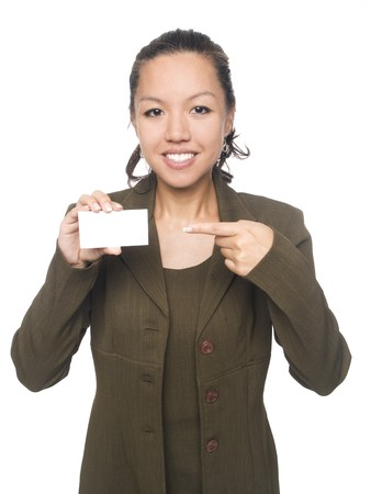 Isolated studio shot of a businesswoman smiling and pointing to her new blank business card. Stock Photo - 8081603