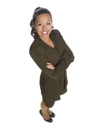 Isolated high angle studio shot of a businesswoman smiling at the camera with her arms crossed. Stock Photo - 8081203