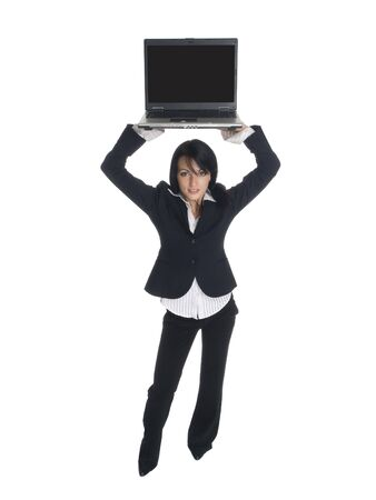 Isolated studio shot of a businesswoman holding a laptop computer over her head. photo