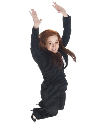 Isolated studio shot of a businesswoman midair jumping for joy photo