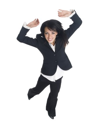 Isolated studio shot of a businesswoman leaping for joy.  Small motion blur on hand and foot. Stock Photo