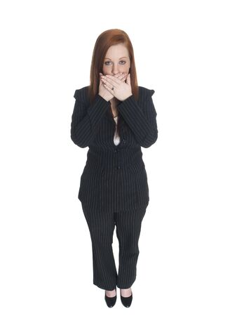 embarassed: Isolated studio shot of a businesswoman in the Speak No Evil pose.