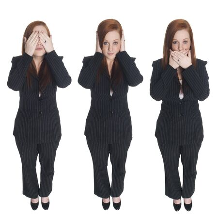 Isolated full length studio shot of a businesswoman in the Speak No Evil pose.