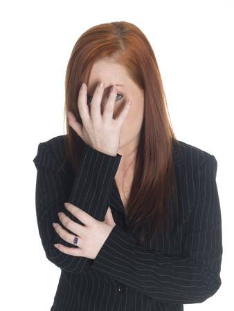 cant: Isolated studio shot of a businesswoman who is peeking even though she just cant look. Stock Photo