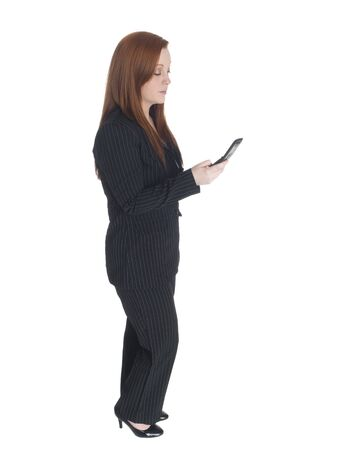 Isolated studio shot of a businesswoman sending a text message on her cell phone. Stock Photo - 8081108