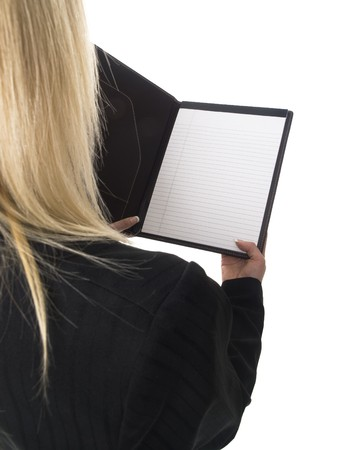 well read: Isolated studio shot of a businesswoman reading a page from her notepad. Stock Photo