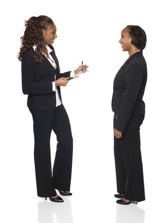 dgf15: A businesswoman writes down answers on a questionaire or fills out forms during an interview.