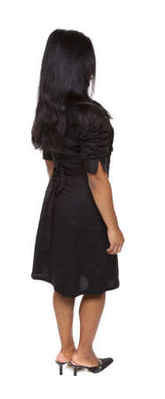rotational: Isolated full length studio shot of the front view of a Latina woman in a dress facing away (part of a 360 rotational series)