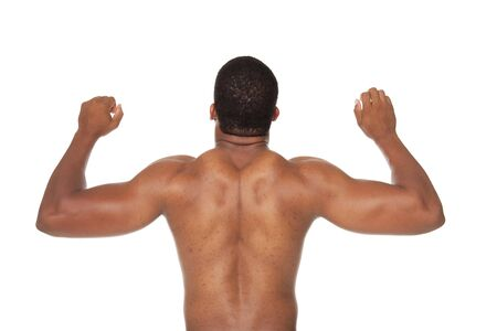 Isolated studio shot of a muscular mans back muscles. photo