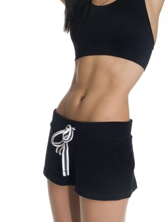 Isolated studio shot of a woman in a fitness outfit.
