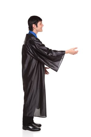 Isolated studio shot of a happy graduate in a college graduation gown with a big smile reaching out to shake hands or takea  diploma. Stock Photo - 8081602