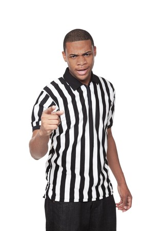 referees: Isolated studio shot of a young African American man in a Referee shirt looking at the camera angrily. Stock Photo