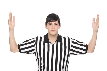 referee: Isolated studio shot of a Caucasian man wearing a referee shirt and making a touchdown hand signal.