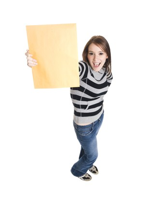 envelope: Isolate studio shot of a casually dressed young adult woman grinning as she holds up a manilla envelope. Stock Photo