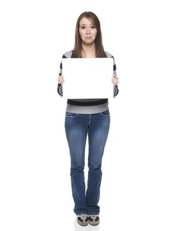 Isolate studio shot of a casually dressed young adult woman holding a blank sign with a sad expression on her face. Stock Photo - 8081157