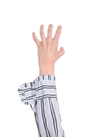 clawing: Closeup isolated studio shot of a womans outstretched hand with fingers held as if clawing.