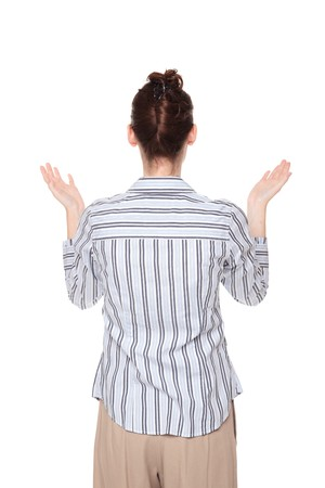 disbelief: Isolated studio shot of a Caucasian woman looking up with arms raised in disbelief Stock Photo