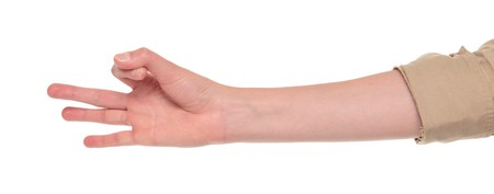 Closeup isolated studio shot of the front view of a womans outstretched hand in a European style number three sign Stock Photo