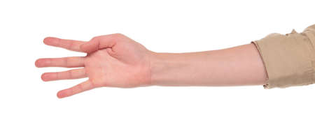 dgf22: Closeup isolated studio shot of the front view of a womans outstretched hand in a number four sign