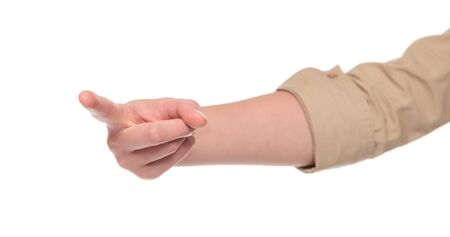 Closeup isolated studio shot of the front view of a womans outstretched hand pointing with her finger at the camera. Stock Photo - 8046714