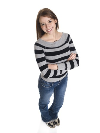 Isolated high angle studio shot of a casually dressed young adult female college student smiling at the camera. photo