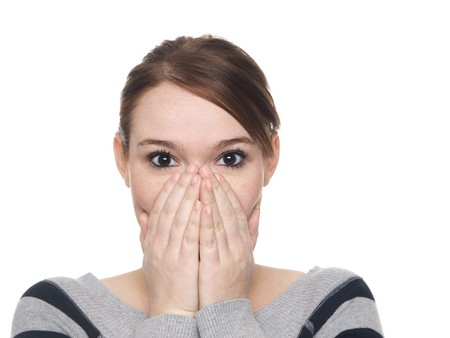 Isolate studio shot of a casually dressed young adult woman covering her mouth in surprise with eyes wide. Stock Photo - 8081399