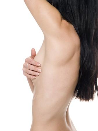 Une femme, effectuer un examen self pour le cancer du sein.