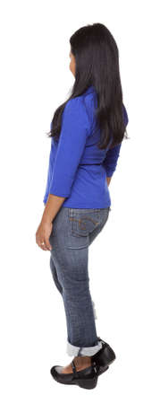 rotational: Isolated full length studio shot of the rear view of a Latina woman in a blue shirt and jeans facing away from the camera (part of a 360 rotational series) Stock Photo