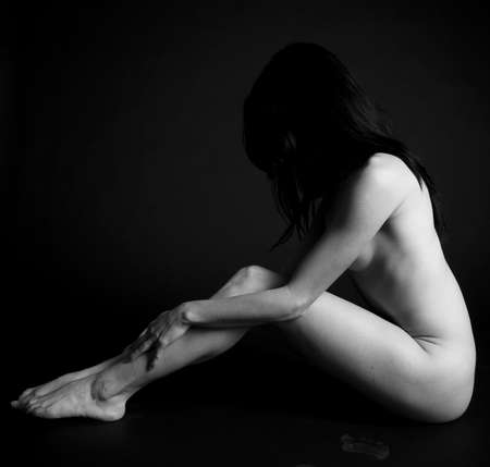 naked black women: A woman in a classic nude pose.