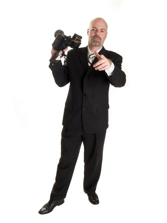 Stock photo of a well dressed wedding photographer, pointing at the camera.  Isolated on white. photo