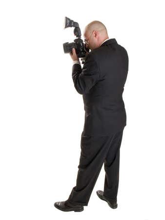 Stock Foto van een goed geklede bruiloft fotograaf.  Volledige lengte, geïsoleerd op wit.